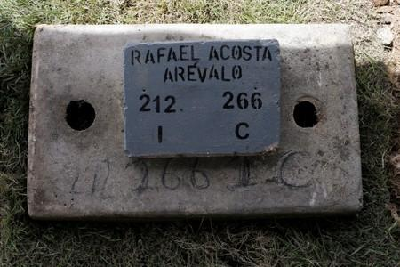 The name of Rafael Acosta Arevalo, a navy captain who died while in detention according to his family, is seen at his grave after a burial at a cemetery in Caracas