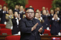 """In this photo provided by the North Korean government, North Korean leader Kim Jong Un claps his hands at the ruling party congress in Pyongyang, North Korean, Sunday, Jan. 10, 2021. Kim was given a new title, """"general secretary"""" of the ruling Workers' Party, formerly held by his late father and grandfather, state media reported Monday, Jan. 11, in what appears to a symbolic move aimed at bolstering his authority amid growing economic challenges. Independent journalists were not given access to cover the event depicted in this image distributed by the North Korean government. The content of this image is as provided and cannot be independently verified. Korean language watermark on image as provided by source reads: """"KCNA"""" which is the abbreviation for Korean Central News Agency. (Korean Central News Agency/Korea News Service via AP)"""