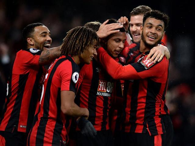 Bournemouth come from behind to win as Paul Lambert's Stoke City drop into the relegation zone