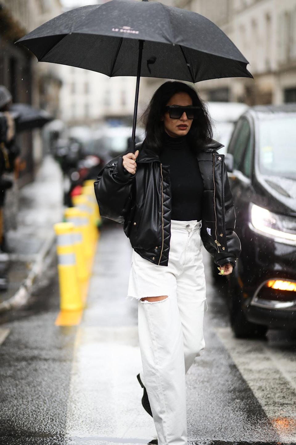 <p>A black-and-white color palette instantly elevates a ripped pair of baggy jeans. </p>