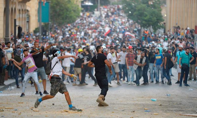 Protesters clash with police close to the Lebanese parliament building.