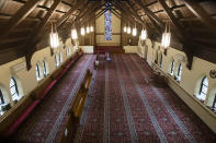 FILE - In this Thursday, April 23, 2020 file photo, the Prayer Hall at the Islamic Cultural Center of Willow Grove in Willow Grove, Pa., stands empty during the holy month of Ramadan, due to social distancing guidelines during the coronavirus outbreak. (AP Photo/Matt Rourke)