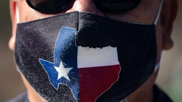 PHOTO: A man wears a Texas-themed mask on March 3, 2021 in Austin, Texas. Gov. Greg Abbott announced a new executive order that will end the statewide mask mandate and allow businesses to reopen at 100% capacity on March 10, 2021.  (Montinique Monroe/Getty Images)