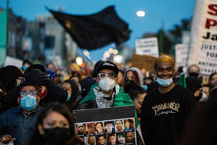 March In Protest Of Police Killing Of Adam ToledoA protester marches down the street while holding a sign commemorating people killed by Chicago Police in Chicago on April 16, 2021. Thousands of protesters came out to call for police accountability after an officer shot and killed 13 year old Adam Toledo in the Little Village neighbourhood on Chicago's south side.