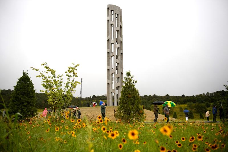 The Tower of Voices stands above visitors, dignitaries and family members of the victims of Flight 93 at the Flight 93 National Memorial Shanksville, Pennsylvania (AFP Photo/JEFF SWENSEN)