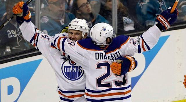 Edmonton Oilers' Zack Kassian, left, celebrates his goal wit teammate Leon Draisaitl (29) during the third period in Game 3 against the San Jose Sharks. (Marcio Jose Sanchez/AP)