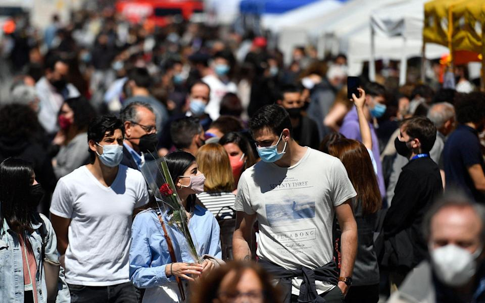 Face masks are mandatory in crowded outdoor spaces - Getty
