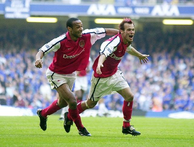 Freddie Ljungberg, right, celebrates with Thierry Henry after sealing Arsenal's 2002 success over Chelsea