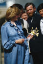 <p>Princess Diana wears a Catherine Walker maternity dress on a visit to St. Mary's on the Isles of Scilly in April 1982. (Photo: Getty Images) </p>