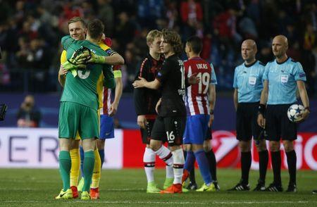 Bayer Leverkusen's Bernd Leno with Atletico Madrid's Jan Oblak after the match