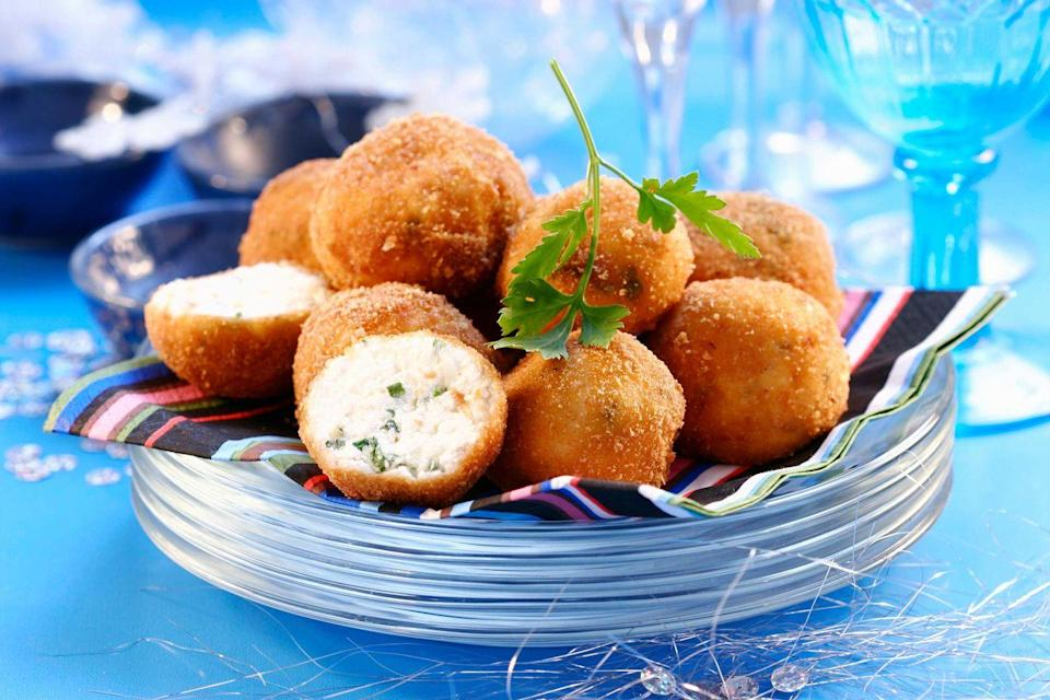 "<p>Our mouths are already watering from the sound of these fried cheese balls. Typically found at beach bars around the island of <a href=""https://www.curacao.com/en/"" rel=""nofollow noopener"" target=""_blank"" data-ylk=""slk:Curaçao"" class=""link rapid-noclick-resp"">Curaçao</a>, these cheese balls are made using Gouda cheese. They're the epitome of a comfort food dish as this snack will hold you over until <a href=""https://www.countryliving.com/life/entertainment/a32316525/blue-bloods-virtual-reagan-family-dinner/"" rel=""nofollow noopener"" target=""_blank"" data-ylk=""slk:dinnertime"" class=""link rapid-noclick-resp"">dinnertime</a>.</p><p><strong>Get the recipe at <a href=""https://www.antillean-eats.com/Recipes/Appetizer/Cheese-Balls/Kaasbal/"" rel=""nofollow noopener"" target=""_blank"" data-ylk=""slk:Antillean Eats"" class=""link rapid-noclick-resp"">Antillean Eats</a>.</strong></p>"