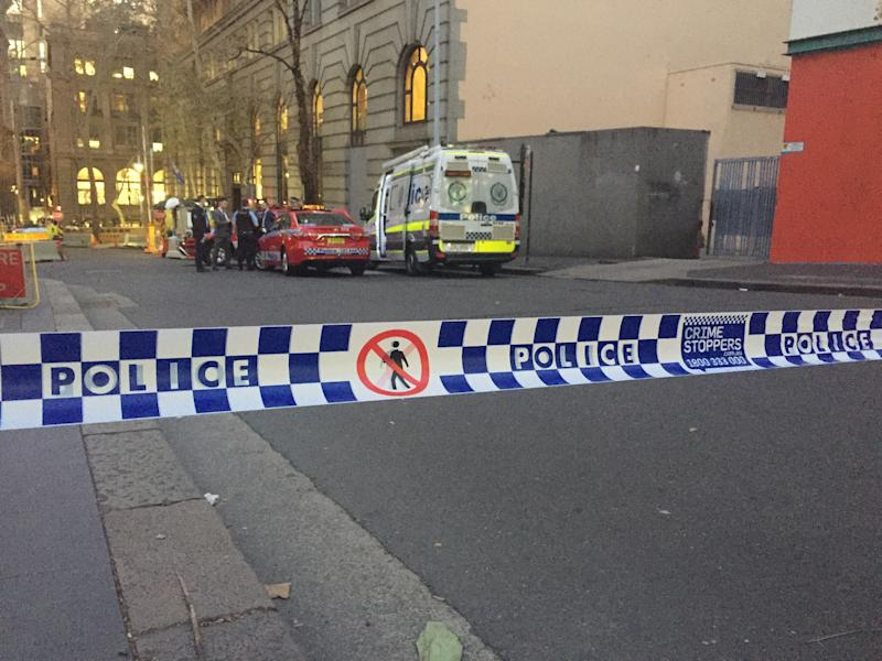 Emergency services at a police cordon in Sydney, Australia near to the scene where a knife attacker was earlier apprehended by members of the public using chairs and a milk crate.