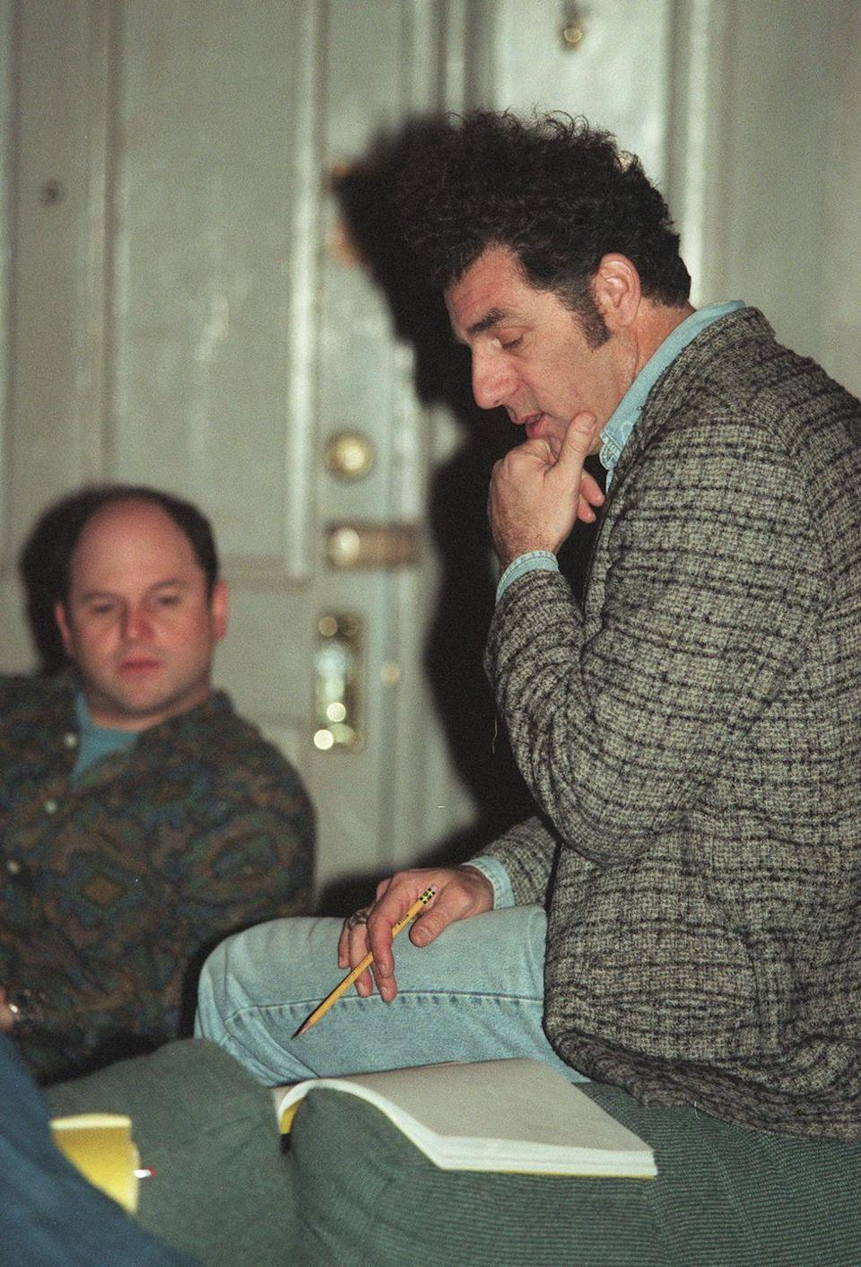 <p>Alexander and Richards are seen on the set reviewing their scripts for an episode during the seventh season.</p>