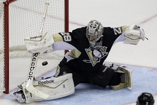 Pittsburgh Penguins goalie Marc-Andre Fleury (29) blocks a shot in the first period of an NHL hockey game against the Buffalo Sabres in Pittsburgh Saturday, Oct. 5, 2013. The Penguins won 4-1. (AP Photo/Gene J. Puskar)
