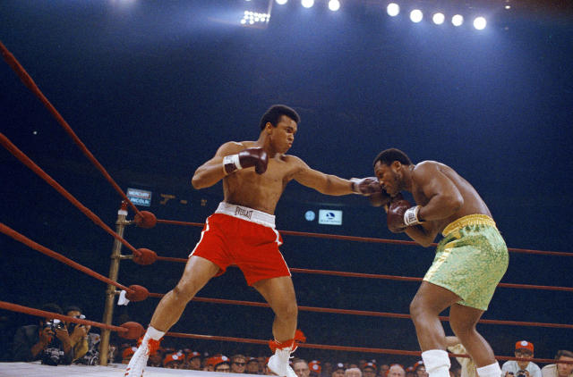 <p>Muhammad Ali, red trunks, and Joe Frazier, green trunks, are shown during round 5 or 6 of their bout in New York's Madison Square Garden, March 8, 1971. (John Lindsay/AP Photo) </p>