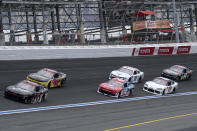 Cars move through Turn 4 during a NASCAR Xfinity Series auto race at Charlotte Motor Speedway, Saturday, May 29, 2021, in Charlotte, N.C. (AP Photo/Ben Gray)