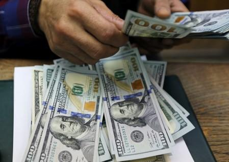 Cautious optimism supports dollar ahead of ECB