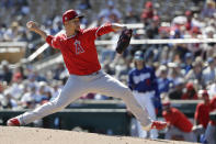 FILE - Then-Los Angeles Angels relief pitcher Hansel Robles works against a Los Angeles Dodgers batter during the third inning of a spring training baseball game in Glendale, Ariz., in this Wednesday, Feb. 26, 2020, file photo. The Minnesota Twins signed Alex Colomé away from their chief divisional competition, the Chicago White Sox, to bring in a proven closer to the back of the bullpen. The Twins won't formally assign that role, though, with Taylor Rogers, Hansel Robles and Tyler Duffey all in position for ninth-inning outs. (AP Photo/Gregory Bull, File)