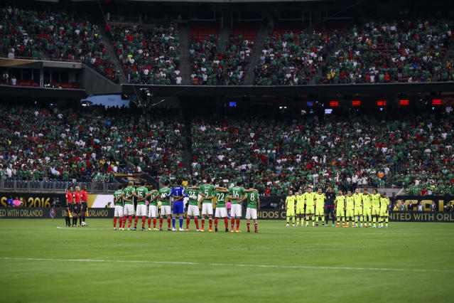 <p>Mexico and Venezuela players pause for a moment of silence in honor of victims of the Orlando mass shooting before a match during the group play stage of the 2016 Copa America Centenario at NRG Stadium on June 13, 2016 in Houston, Texas. ( Photo: Troy Taormina/USA TODAY Sports/Reuters) </p>