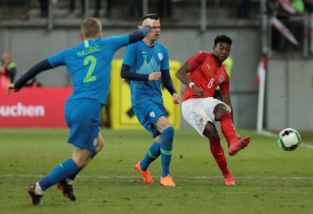 Soccer Football - International Friendly - Austria vs Slovenia - Worthersee Stadium, Klagenfurt, Austria - March 23, 2018 Austria's David Alaba in action with Slovenia's Josip Ilicic REUTERS/Heinz-Peter Bader