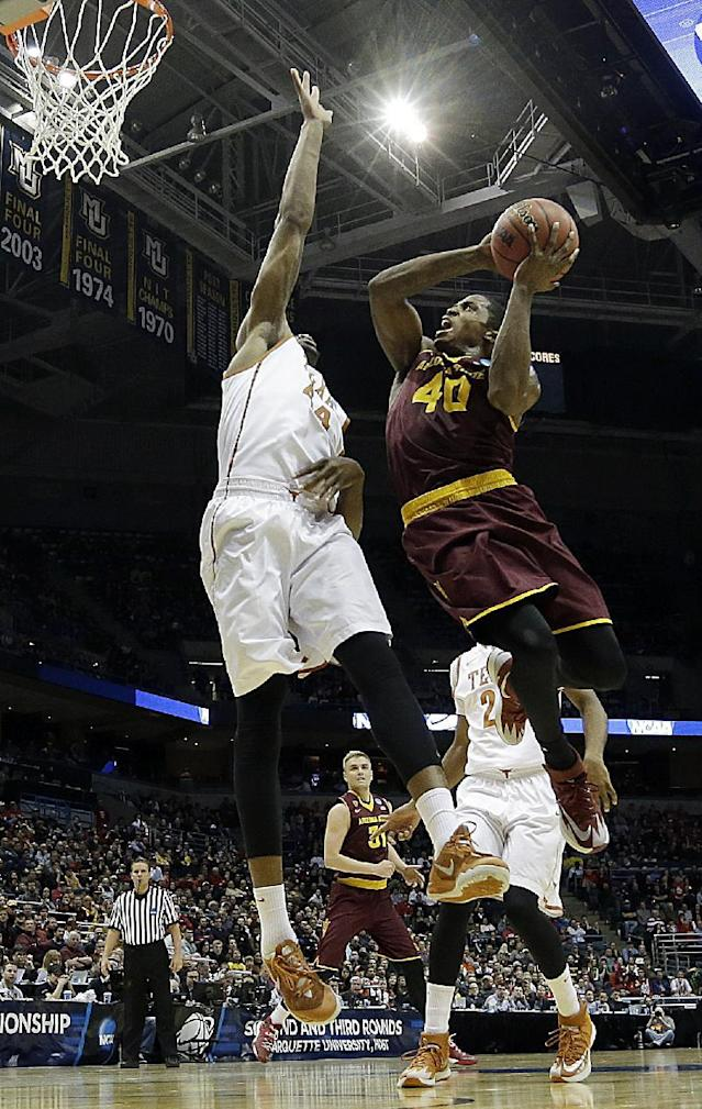 Arizona State guard Shaquielle McKissic (40) goes up for a shot against Texas center Prince Ibeh (44) during the first half of a second round NCAA college basketball tournament game Thursday, March 20, 2014, in Milwaukee. (AP Photo/Morry Gash)