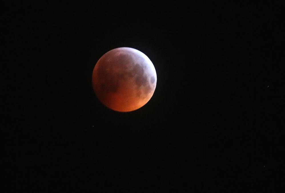 <p>A super blood wolf moon in the sky above Edinburgh during a lunar eclipse (Picture: PA) </p>