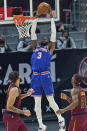 New York Knicks' Nerlens Noel (3) dunks against the Cleveland Cavaliers during the first half of an NBA basketball game Friday, Jan. 15, 2021, in Cleveland. (AP Photo/Tony Dejak)