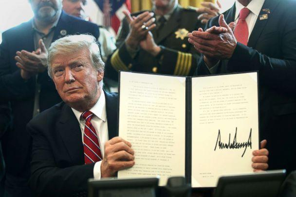 PHOTO: President Donald Trump holds an executive veto, his first as president, in the Oval Office, March 15, 2019. President Trump vetoed the congressional resolution that blocks his national emergency declaration on the southern border. (Alex Wong/Getty Images)