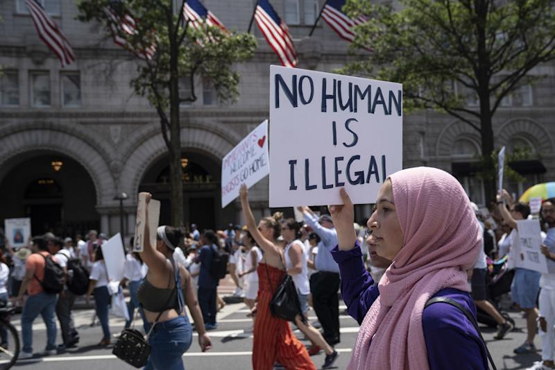 The Most Powerful Signs From the 'Families Belong Together' Marches