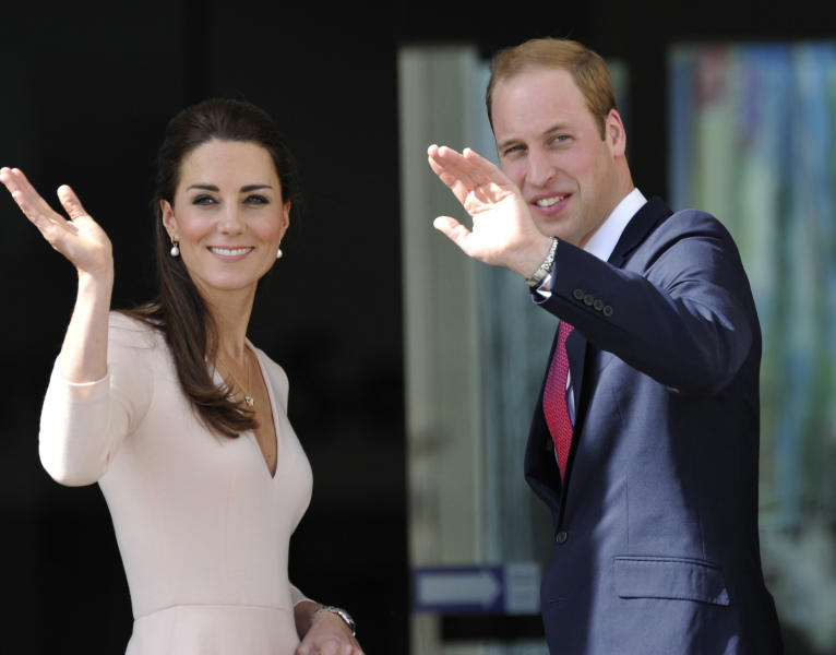 Britain's Prince William, right, and his wife Kate, left, the Duchess of Cambridge, wave to the crowd. Wednesday, April 23, 2014, in Adelaide, Australia. (AP Photo/David Mariuz)