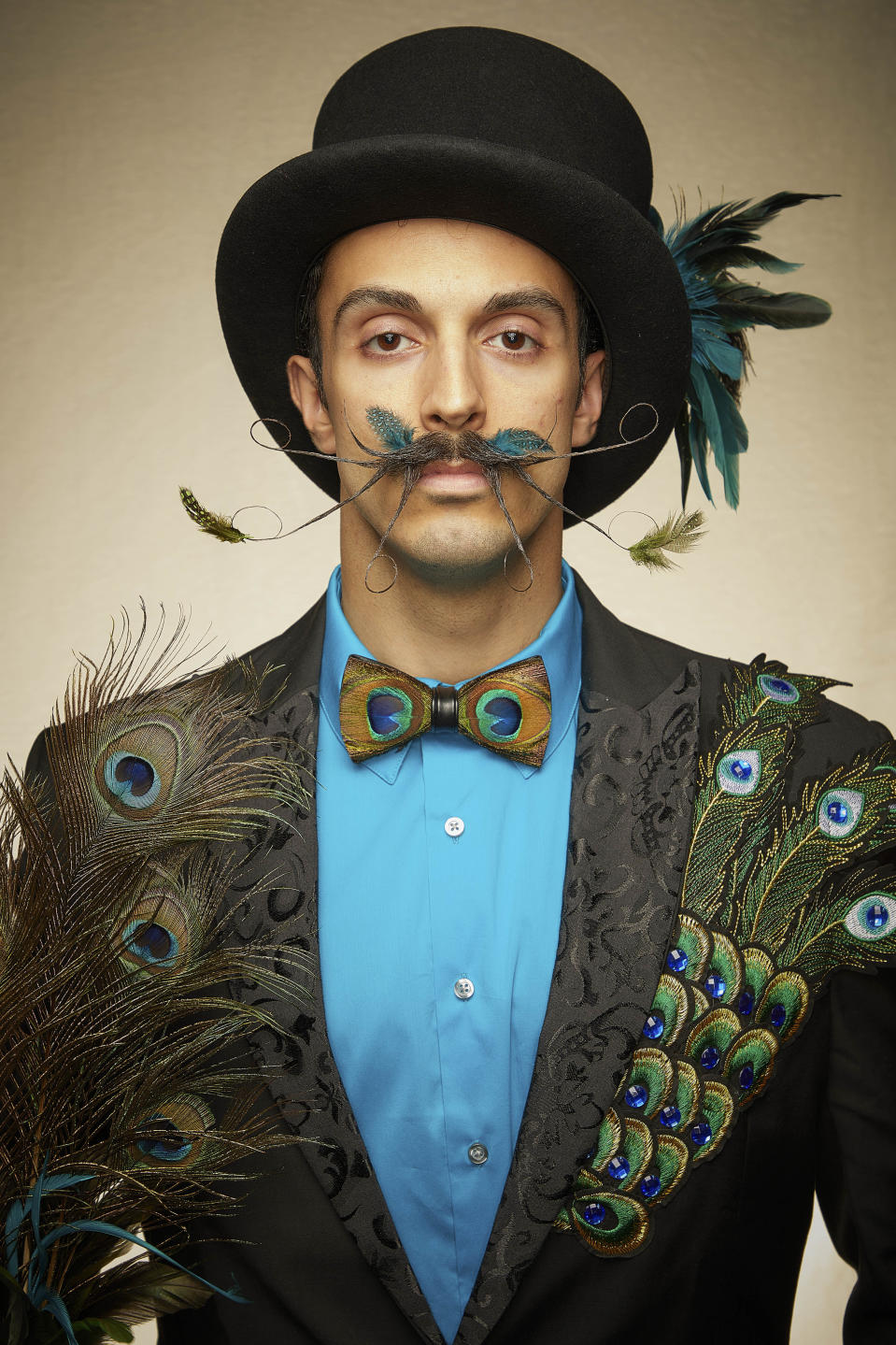 This peacock inspired moustache is a true artwork. [Photo: Caters]
