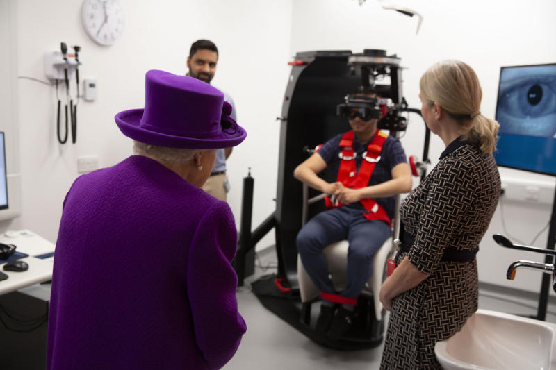 Queen Elizabeth II watching a demonstration with a rotatory chair during the official opening of the new premises of the Royal National ENT and Eastman Dental Hospitals in London.