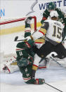 Minnesota Wild's Zach Parise, left, gets upended at the net by Vegas Golden Knights' Jon Merrill in the first period of an NHL hockey game Tuesday, Feb. 11, 2020, in St. Paul, Minn. (AP Photo/Jim Mone)