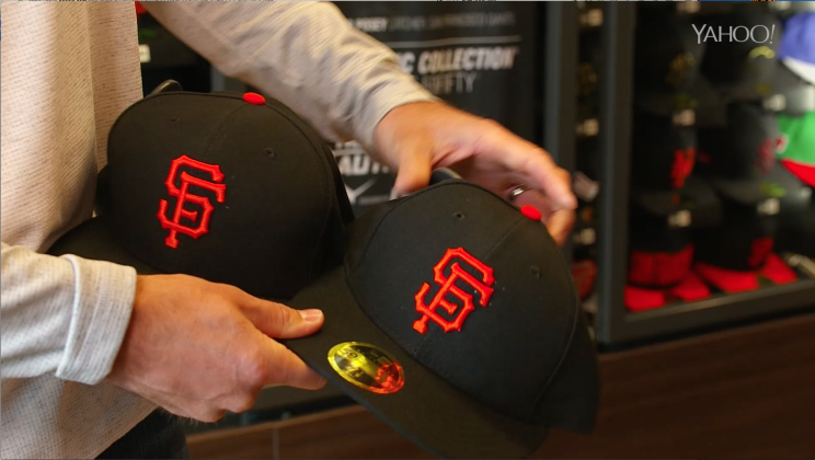 Buster Posey shows the difference in the low-profile New Era cap and the  regular 240cd35ab02