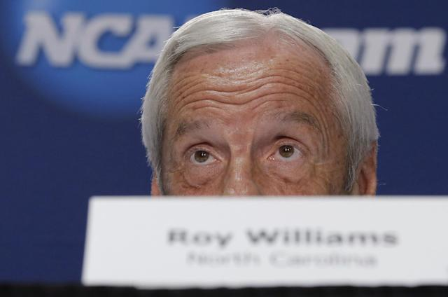 North Carolina coach Roy Williams peers over his nameplate during an NCAA college basketball tournament news conference, Saturday, March 22, 2014, in San Antonio. North Carolina will play Iowa State on Sunday. (AP Photo/Eric Gay)