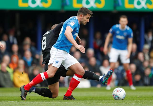 "Soccer Football - League One - Portsmouth vs Wigan Athletic - Fratton Park, Portsmouth, Britain - April 2, 2018 Portsmouth's Gareth Evans in action with Wigan's James Vaughan Action Images/Matthew Childs EDITORIAL USE ONLY. No use with unauthorized audio, video, data, fixture lists, club/league logos or ""live"" services. Online in-match use limited to 75 images, no video emulation. No use in betting, games or single club/league/player publications. Please contact your account representative for further details."