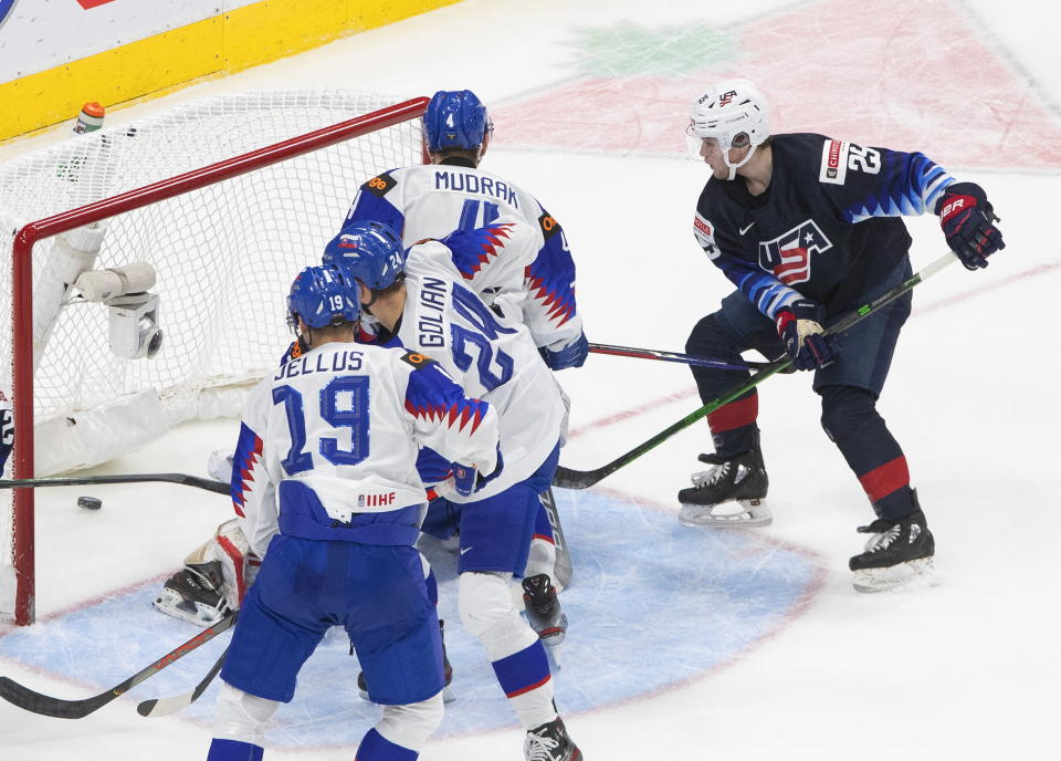 United States' John Farinacci (25) scores a goal against Slovakia during the third period of an IIHL World Junior Hockey Championship game, Saturday, Jan. 2, 2021 in Edmonton, Alberta. (Jason Franson/The Canadian Press via AP)