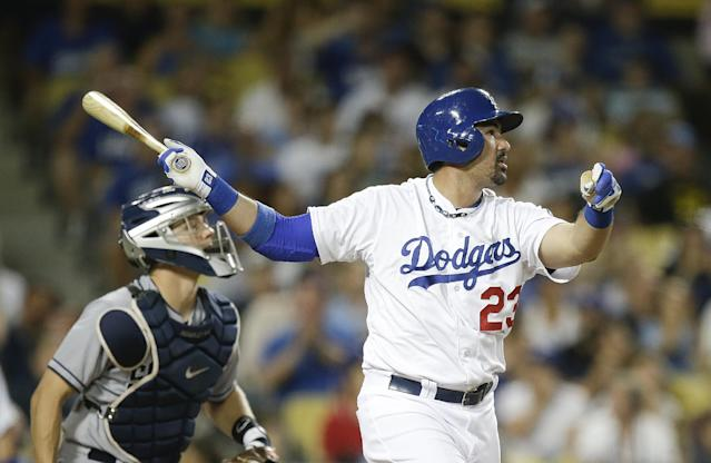 Los Angeles Dodgers' Adrian Gonzalez watches the flight of his two-run home run against the San Diego Padres during the third inning of a baseball game on Friday, Aug. 30, 2013, in Los Angeles. (AP Photo/Jae C. Hong)