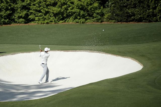Li Haotong of China hits from a sand trap on the 4th hole during second round play of the 2018 Masters golf tournament at the Augusta National Golf Club in Augusta, Georgia, U.S., April 6, 2018. REUTERS/Mike Segar