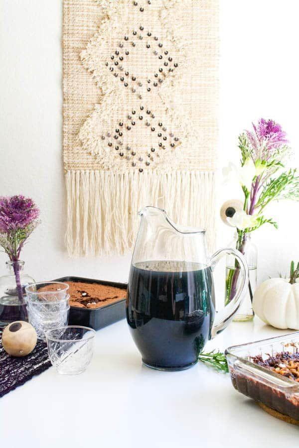 """<p>In a pitcher, combine 1.5 cups of water, 1.5 cups of apple juice, 1.5 cups of lemon juice, and 1.5 cups of vodka. Then, mix in 1 tbsp. of coconut activated charcoal powder with a whisk. Top it off with 1.25 fl oz. of Bundaberg ginger beer and gently stir to combine. </p><p><em>Recipe from <a href=""""https://www.cupcakesandcutlery.com/vodka-halloween-punch/"""" rel=""""nofollow noopener"""" target=""""_blank"""" data-ylk=""""slk:Cupcakes & Cutlery"""" class=""""link rapid-noclick-resp"""">Cupcakes & Cutlery</a>. </em></p>"""
