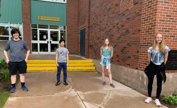 Antonio Moraru, Jerome Chen, Anna Clark and Juliette Bader are on Queen Charlotte's student council, and are pleased with the flag project.