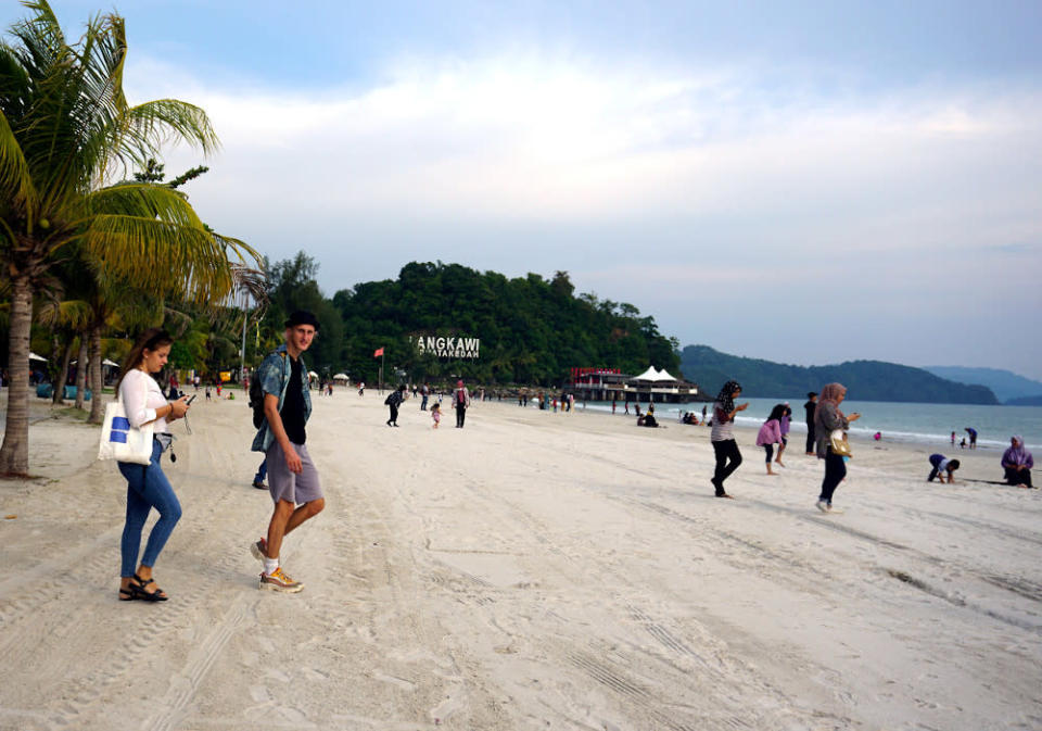 Tourists are seen on Chenang Beach in Langkawi June 12, 2020. — Bernama pic