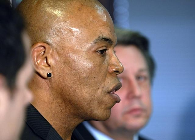 Former Kansas City Chiefs linebacker Chris Martin, left, talks about injuries suffered during his football career as he and his attorney Ken McClain, right, talk about their lawsuit filed today against the Kansas City Chiefs organization during a news conference in Independence, Mo, Tuesday, Dec. 3, 2013. The lawsuit on behalf of five former Kansas City Chiefs players for failing to disclose the dangers of competing after suffering head injuries. (AP Photo/Colin E Braley)
