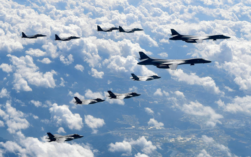 """FILE - In this Sept. 18, 2017, file photo provided by South Korea Defense Ministry, U.S. Air Force B-1B bombers, F-35B stealth fighter jets and South Korean F-15K fighter jets fly over the Korean Peninsula during joint drills. North Korea's supreme decision-making body on Wednesday, Nov. 13, 2019, has lashed out at planned U.S.-South Korean military drills and warned that the United States will face a """"bigger threat and harsh suffering"""" if it ignores North Korean leader Kim Jong Un's end-of-year deadline to salvage nuclear talks. (South Korea Defense Ministry via AP, File)"""