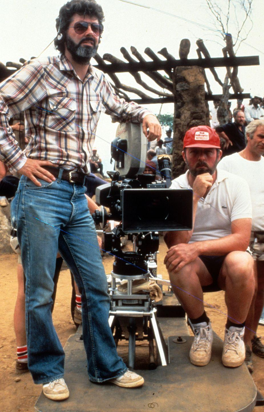 <p>Lucas on set of the film <em>Indiana Jones And The Temple Of Doom</em> in 1984.</p>