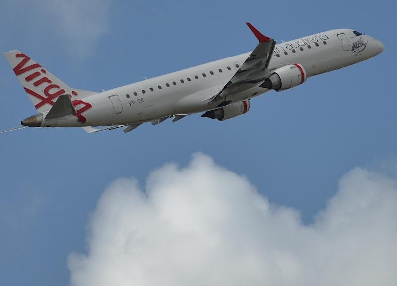 A hoax caller pretending to be air traffic control tapped into restricted radio frequencies and forced a Virgin Australia flight to pull up just before landing at Melbourne's Tullamarine airport (AFP Photo/Peter Parks)