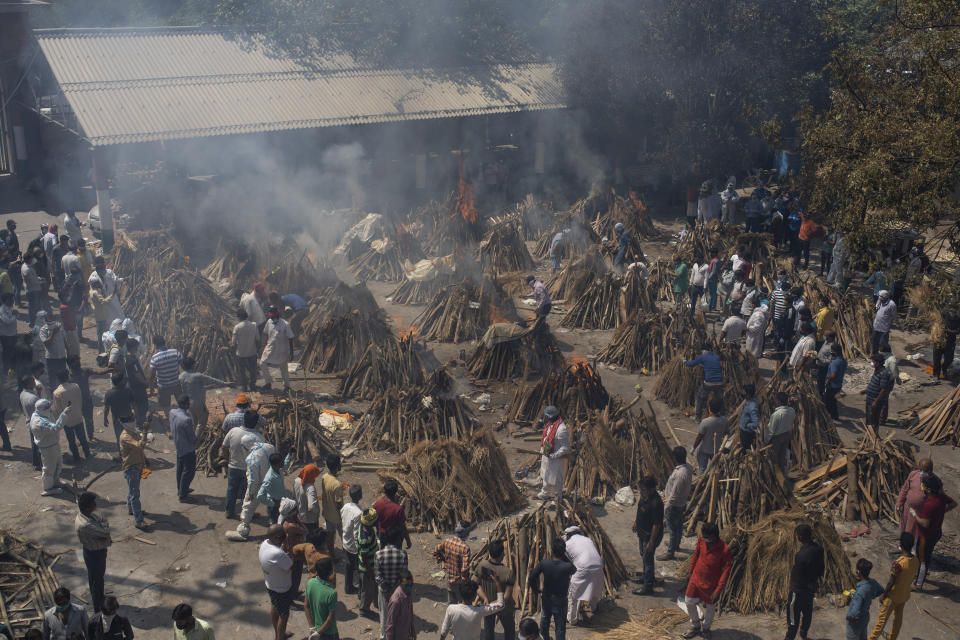 Multiple funeral pyres of those who died of Covid-19 burn at a ground that has been converted into a crematorium for the mass cremation of coronavirus victims, in New Delhi, India. Source: AP Photo/Altaf Qadri