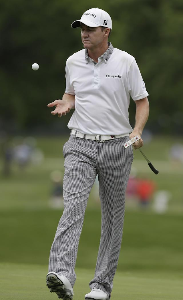Jimmy Walker catches his ball tossed to him by his caddie, not shown, before putting on the third hole during the third round of the PGA Colonial golf tournament in Fort Worth, Texas, Saturday, May 24, 2014. (AP Photo/LM Otero)