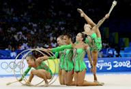 BEIJING - AUGUST 24: The Azerbaijan team perform in the 3 Hoops and 2 Clubs rotation in the Group All-Around Final held at the Beijing University of Technology Gymnasium during Day 16 of the Beijing 2008 Olympic Games on August 24, 2008 in Beijing, China. (Photo by Nick Laham/Getty Images)