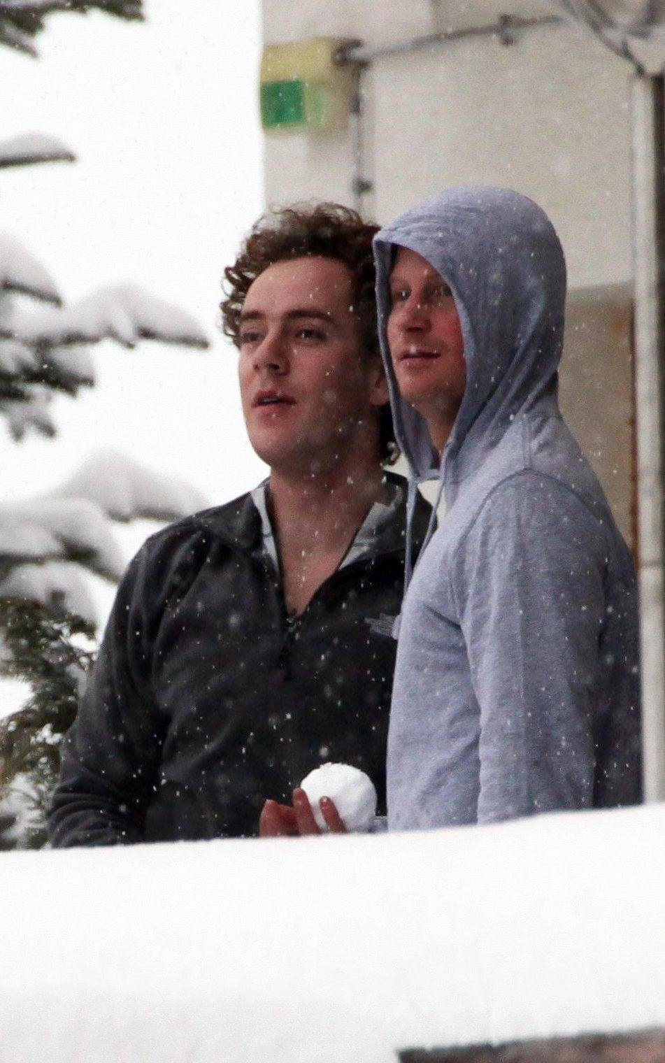 Prince Harry and his friend Tom Inskip throw snowballs from a hotel balcony at the Swiss resort of Verbier - Mark Large/ANL/Shutterstock